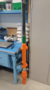 Test set up using gravity to simulate plunger arrival